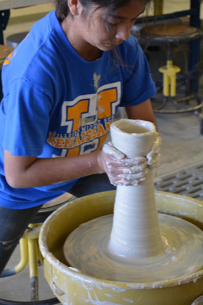 Zalma Quezada throws her entry for the Tallest Wheel Thrown Pot contest.