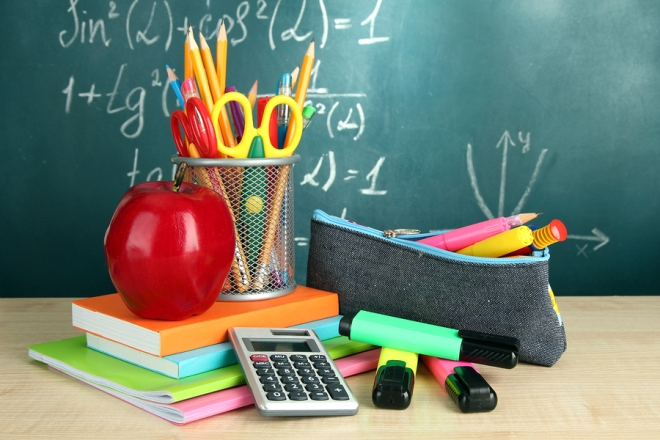 Back to school - blackboard with pencil-box and school equipment