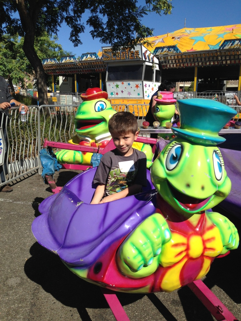 Matthew Slaby, 6, enjoying one of the rides at the Simi Valley Days Carnival Special Children's Day.