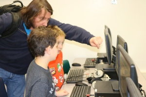 Dad John Brinkman helps his son Theodore (in orange) and Josh Abugow, work their way through an Angry Birds coding game. Brinkman is a computer programmer. The boys are second graders at Wood Ranch Elementary, which held its Hour of Code on Dec. 8.