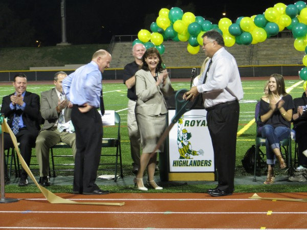 Principal Keith Derrick, Director of Secondary Education Deborah Salgado and Assistant Superintendent of Personnel Dan Houghton all helped cut the ribbon for the new track on Monday. Salgado and Houghton were both former Royal principals.
