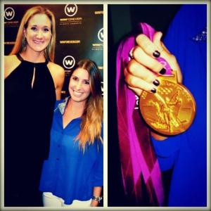 Emilie Mateu stands with Kerri Walsh Jennings, the three-time gold medalist in Women's Beach Volleyball. This picture was taken during the 2012 Summer Olympics in London.