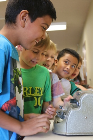 First graders at Garden Grove Elementary try out the Braille machine. Braille is a system of raised dots on paper that enable the visually impaired to read books.